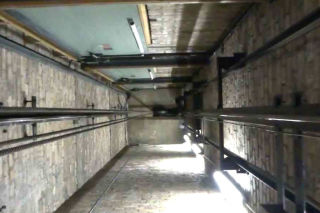 How to remove water damage from a lift well elevator shaft